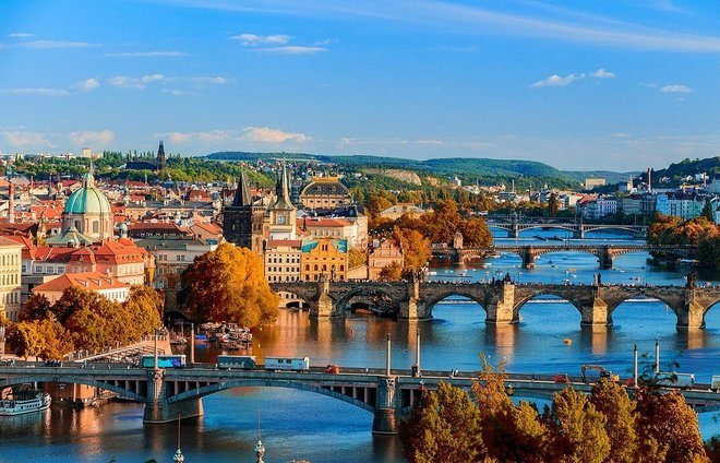 Appreciate the beauty of Prague from the stunning waterfront of the Vlatava River.
