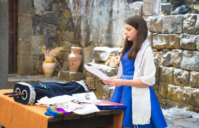Bat mitzvah girl in a ceremony