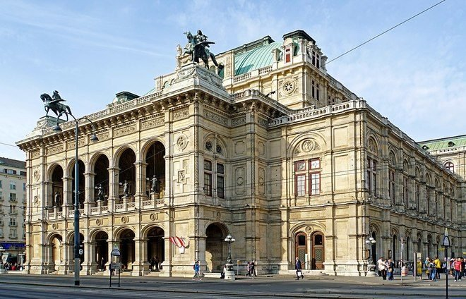Experience the Vienna State Opera, with its luxurious hall, beautifully dressed guests, and the symphony orchestra's flawless music.