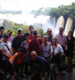Group with falls in background