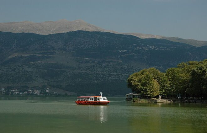 Enjoy an idyllic boat ride on Pamvotis lake, in the shadows of the towering mountains that surround it.