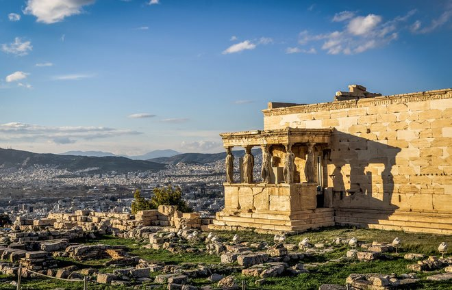 Go up to the Acropolis, an ancient citadel located above the city of Athens and the most well-known landmark of Greece.