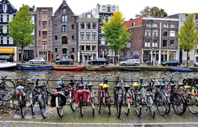 Make like a local and explore Amsterdam by bike. The city has 881,000 bikes and there is no better way to experience its beauty and learn about its often-surprising culture.