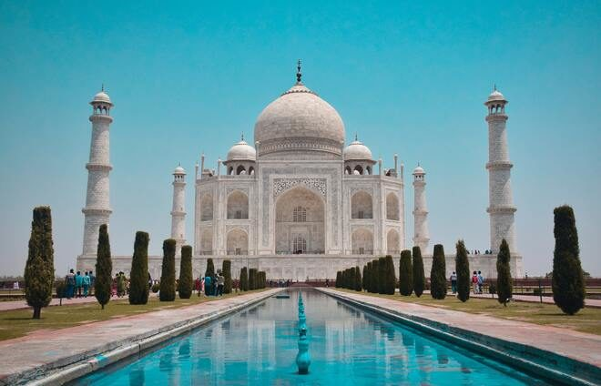 Explore the Taj Mahal in the morning light, followed by a walk through the garden and the reflecting pools. The awe-inspiring, UNESCO recognized, 17th century mausoleum, built with the help of 20,000 artisans over 22 years, stands as the pinnacle of Mughal art.