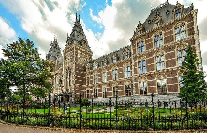 Explore Amsterdam's must-see museums: The Rijksmuseum, displaying Rembrandt's masterpiece The Night Watch and Vermeer's famous The Milkmaid, and the Van Gogh museum, which houses the world's largest collection of artworks by Vincent van Gogh, including Sunflowers, Almond Blossom, and The Potato Eaters.