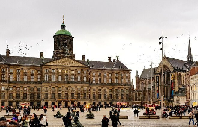 Enjoy an introductory walking tour through Amsterdam's alleys and canals and pass by the Royal Palace, situated on the west side of Dam Square, and the famous National Monument, a 72-ft concrete conical pillar covered by white travertine stone.