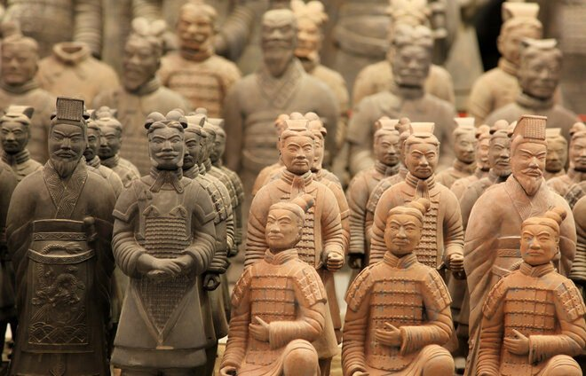 "Examine the Terra Cotta Warriors, thousands of life-size ceramic soldiers and horses ""guarding"" the tomb of China's first emperor."