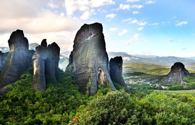 Drive to the region of Meteora, one of the largest and most important complexes of Eastern Orthodox monasteries in Greece. A series of six monasteries sit high above the valley, carved into the natural sandstone.