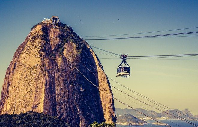 Board a cable car for a two-staged ascent up Sugar Loaf Mountain. Enjoy a breathtaking view of Corcovado, Guanabara Bay, Niteroi, the downtown area, and the beaches.