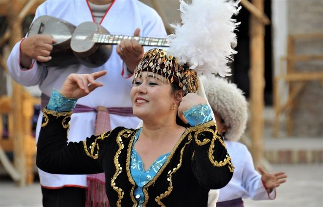 Soak up the local culture at a performance of Uzbekistani song and dance, with dinner.