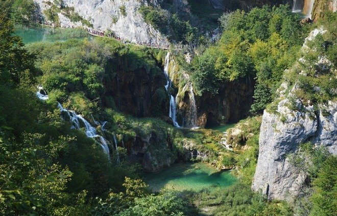 Explore Plitvice Lakes National Park, the largest national park in Croatia, famous for its chain of 16 terraced lakes, joined by waterfalls, that extend into a limestone canyon.