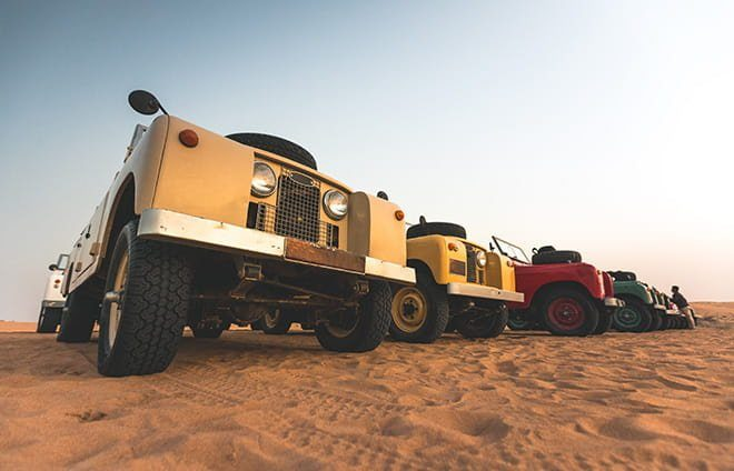 Traverse the desert in museum-quality 1950's vintage Land Rovers. Spot native wildlife like Arabian oryx on a desert drive in the Dubai Desert Conservation Reserve.